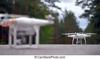 Modern drone takes off in slow motion. - A quadrocopter is...
