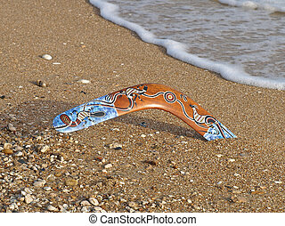 Boomerang - Colorful boomerang on a sandy beach