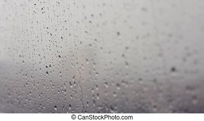 Rain drops on glass. Window. Side view shallow depth of field