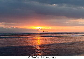 View at Bali island at sunset - View at Bali island from...
