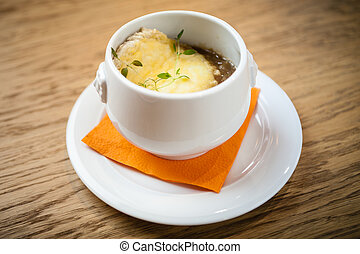 French onion soup. With cheese gruyere, under the hat of...
