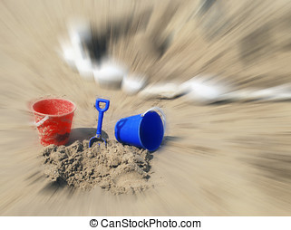 Bucket and spade with blur - Bucket and spade near sand...