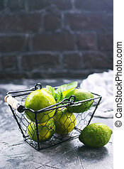limes - fresh limes on the table,stock photo