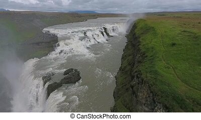 Fog and sprays rise above the waterfall. Panoramic view of...