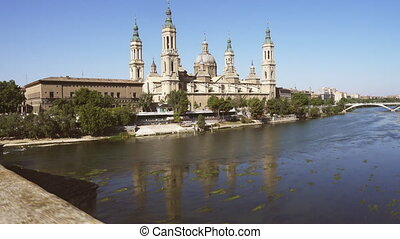 Walking over the bridge with El Pilar in the background -...