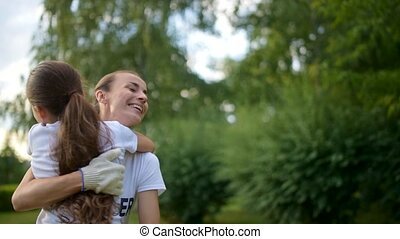 Adorable girl rushing into arms of female volunteer - Warm...