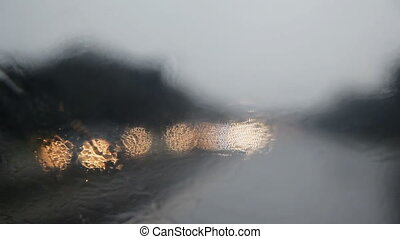 Colorful bokeh motion on a rain Defocussed blurry light from...