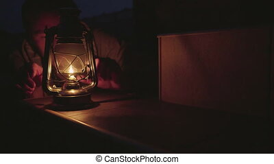Male with oil lamp in the evening. - Caucasian man lights a...