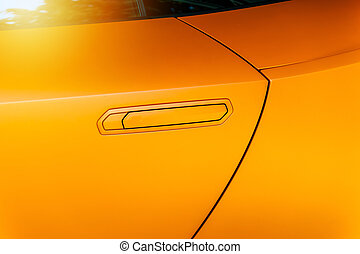 Car door handle of an orange modern car