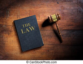 Law book and gavel on wooden background. 3d illustration