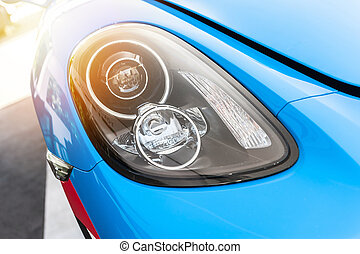 Close up of a blue sport luxury car in sunset
