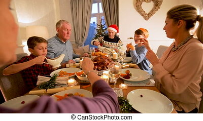 Family Christmas Dinner - Family are sitting at the dining...