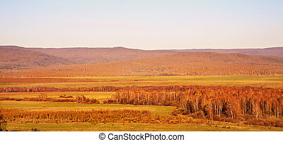 Scenic autumn landscape. meadow, forest and mountains