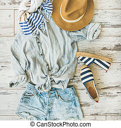 Summer outfit flatlay, parquet background, top view, square...
