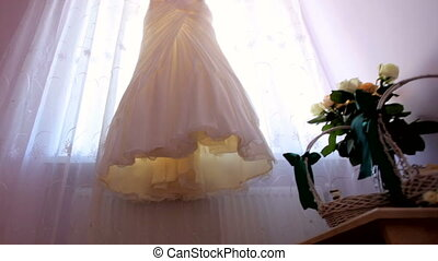 Wedding day. bride's dress hangs on the window in the room