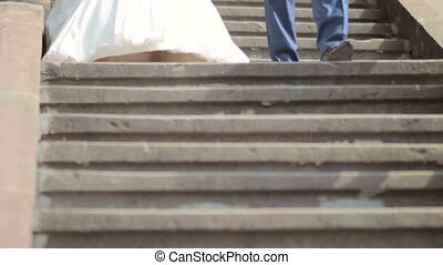 bride and groom descend the stairs. Wedding day