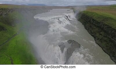 River falls on cascading waterfall Gullfoss. Andreev.