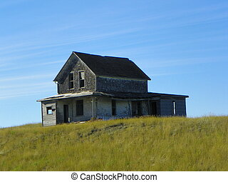 Old house on a grassy hill