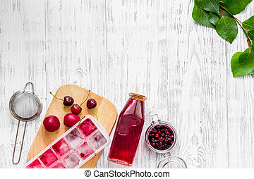 Cranberry morse with cherry and pulm on wooden table...