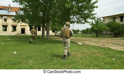 Army intervention troops assigned to patrol a rural area...
