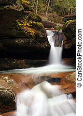 Woodland Waterfalls - Cascading waterfall in the forest with...
