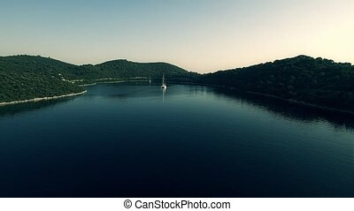 Yacht on island Mljet aerial - Copter aerial view of the...