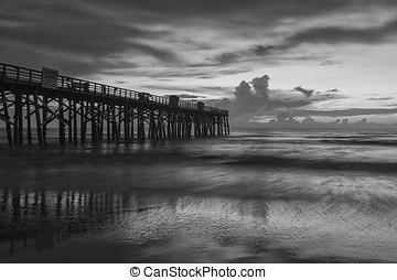 B&W of Flagler Beach pier. - A B&W image of sunrise over the...