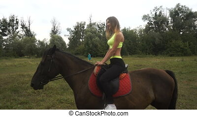 attractive athletic girl rides big horse - beautiful girl...