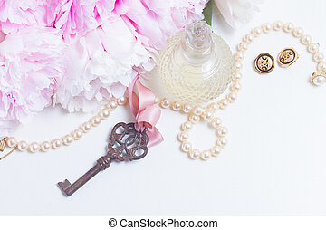 Skeleton key with peony flowers, glamour bottle and...