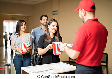 People waiting in line to see a movie
