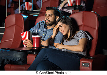 Scared girlfriend at the movies