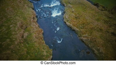 Aerial view of the river in the valley became a powerful...