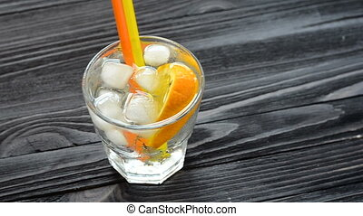 Cocktail with citrus fruits on dark wooden table - Hand...