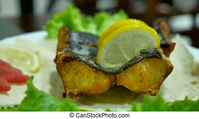 Dish of fish. Fried shark eating on a plate with lemon....