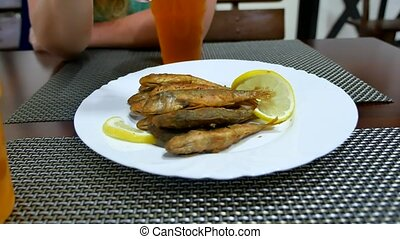 Fried surmullet fish on a plate with lemon. Delicious dinner...