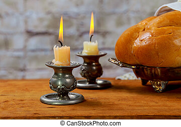 Shabbat with lighted candles, challah bread and wine. -...