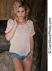 Blonde - Beautiful blonde in an Old West blacksmith shop