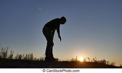 Man doing Push up sport silhouette sunlight sunset - Man...