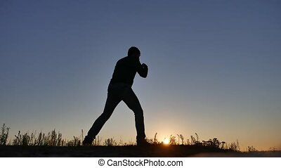 athlete man silhouette boxing at the beach nature sport Sunset sunlight