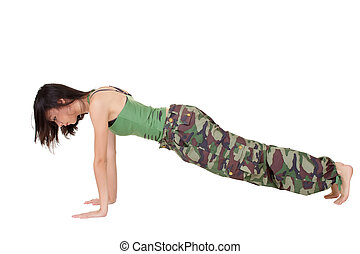 push-up - Young woman doing excisepush-up isolated over...