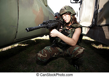 Sexy military woman with rifle