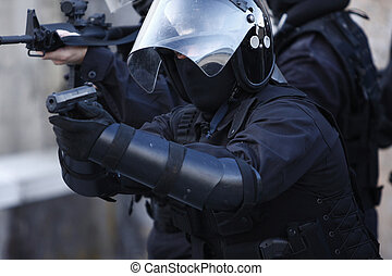 Specialized Police Unit - SWAT officers in full tactical...