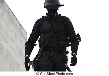 Specialized Police Unit - SWAT officer in full tactical...