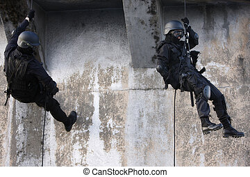 Specialized Police Unit - SWAT officer on a rope.
