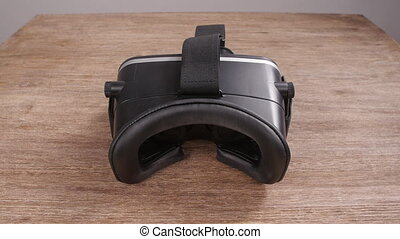 Put on virtual reality glasses from the first person - A man...