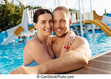 Lovely couple bonding in a swimming pool