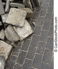 stacked pavement tiles on sidewalk