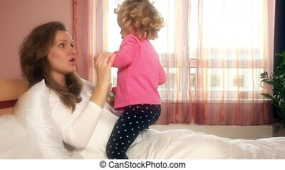 Lovely girls mother and little daughter show feelings in...