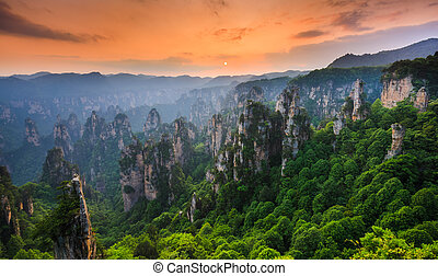 Zhangjiajie National forest park at sunset, Wulingyuan,...