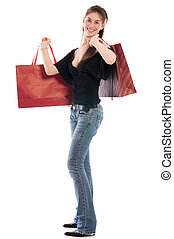 Happy shopper - Young happy girl holding paper bags